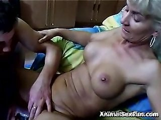 Busty blond-haired babe gets gaped by a horny dog