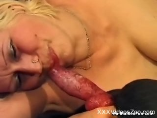 Bleached Latina eagerly sucking on a dog's red cock