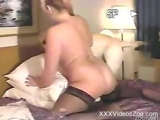 Blond-haired MILF in stockings yearning for dog dick