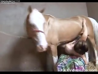 Short-haired chick takes a huge horse cock in her pussy