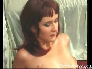 Hard fucking video featuring a redhead and a kinky dog
