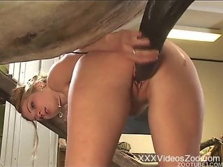 Tatted-up blonde happily fucks a big-dicked stallion